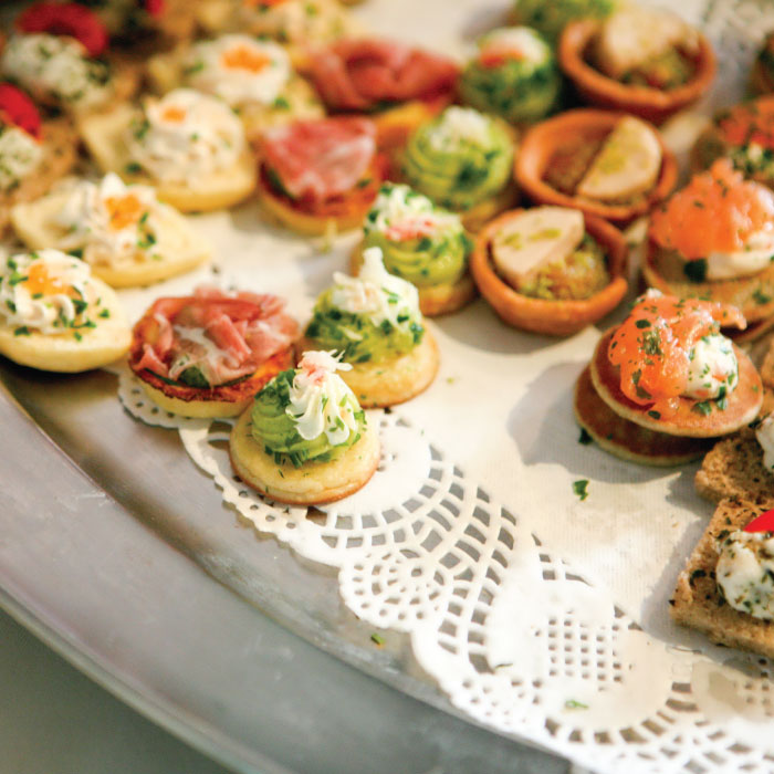 Wedding food including salmon and cream cheese crackers